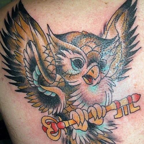 татуировка - совенок с ключиком